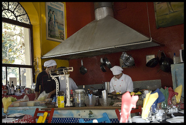 Chefs at work in the kitchen of El Drugstore
