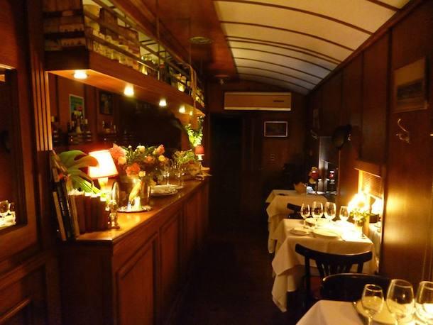 The romantic interior of the dining car of Restaurant del Ferrocarril